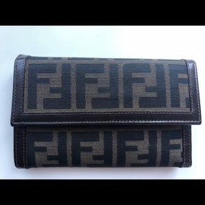 Fendi tri fold long ladies wallet in classic FF